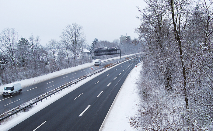 Erlangen,  Germany -DECEMBER 18: German highway in winter period under snow with some cars, daily on December 18.2010 in Erlangen, Germany